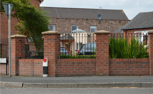 Decorative railings between brick posts