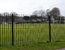 vertical bar fencing around a park